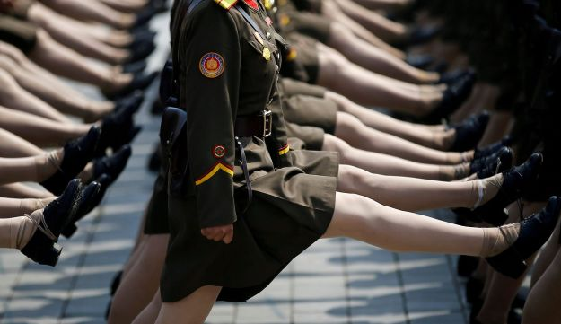 North Korean soldiers march at military parade for 105th birth anniversary of the country