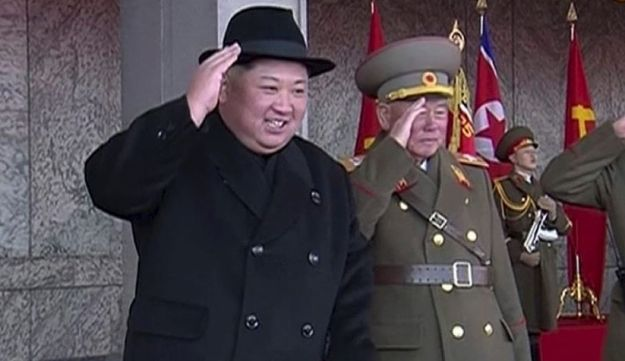 In this image made from video by North Korea's KRT, North Korean leader Kim Jong Un, center, attends a military parade in Pyongyang, North Korea Thursday, Feb. 8, 2018
