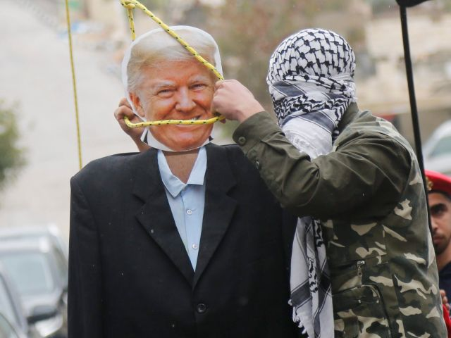 Palestinians hang an effigy of the U.S. President Donald Trump during a protest in Aida refugee camp in the West Bank city of Bethlehem, Saturday, Jan. 27, 2018.(AP Photo/Nasser Shiyoukhi)