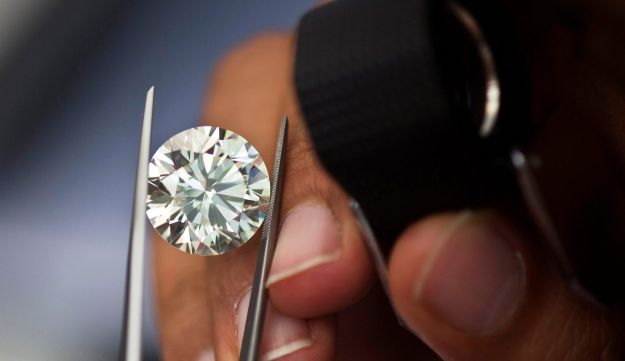 File photo: A trader inspects a diamond during a four-day show at Israel's Diamond Exchange near Tel Aviv.