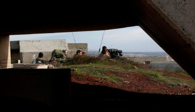 Israeli solders taking positions in the Israeli-occupied Golan Heights near the border with Syria. February 10, 2018