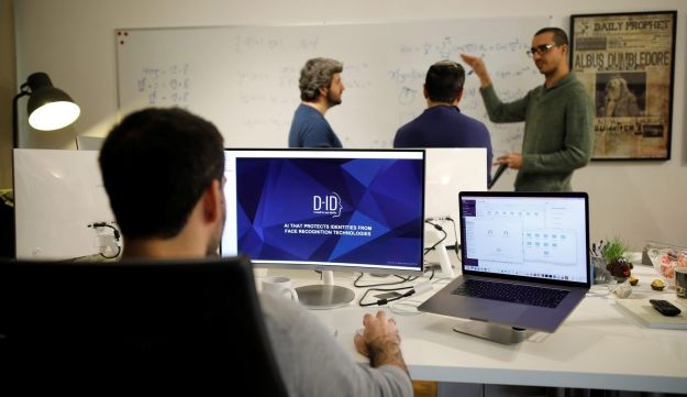 Employees of the D-ID startup company work at the company's office in Tel Aviv, Israel February 7, 2018.