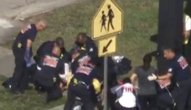 Still from video of rescue workers with a victim near Marjory Stoneman Douglas High School during the shooting incident in Parkland, Florida, February 14, 2018.