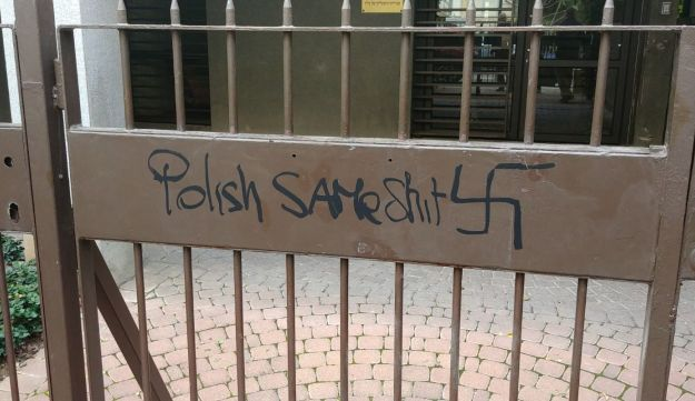 Graffiti sprayed on the gate of the Poland's embassy in Tel Aviv, January 18, 2018.