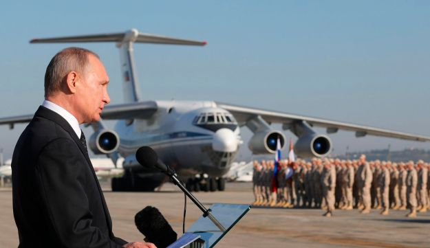 President Vladimir Putin addressing Russian troops at Hemeimeem air base during a surprise visit to Damascus, December 12, 2017.