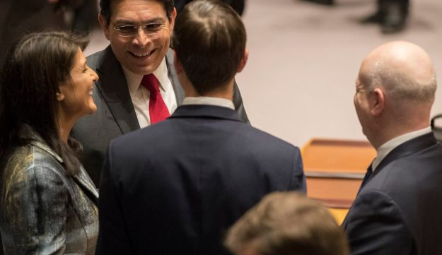 U.S. Ambassador to the UN Nikki Haley talks with Israeli counterpart Danny Danon as Jared Kushner and Jason Greenblatt listen before a Security Council meeting, February 20, 2018.