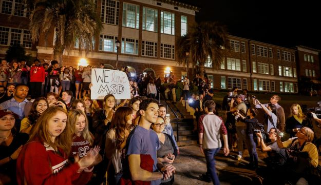 Students from Marjory Stoneman Douglas High School are welcomed as they arrive at another Florida school before meetings with Florida state legislators. Tallahassee, Florida, U.S., February 20, 2018