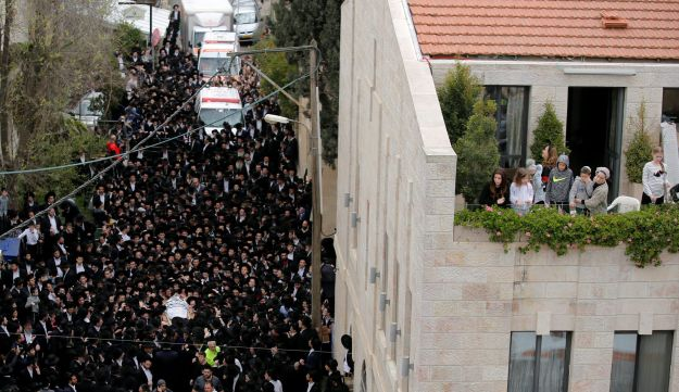 Ultra-Orthodox Jewish men mourn as they carry the body of Rabbi Shmuel Auerbach, head of an ultra-Orthodox Jewish denomination known as the Jerusalem Faction, during his funeral, ebruary 25, 2018.