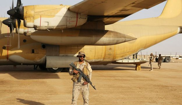 A Saudi soldier guards an aid flight at an air base in Marib, Yemen, February 1, 2018.