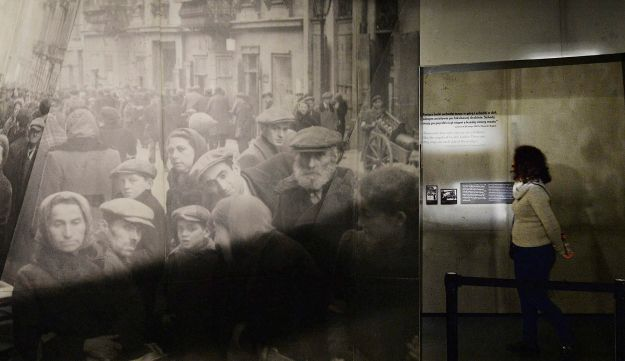 A visitor to the POLIN Museum of the History of Polish Jews looks at exhibits from the WWII Warsaw Ghetto. Warsaw, Poland. Feb. 1, 2018