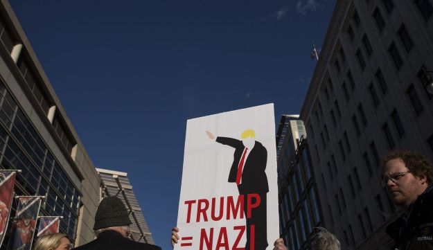 A protester holds a sign outside the American Israeli Public Affairs Committee (AIPAC) policy conference in Washington, D.C., U.S. March 21, 2016