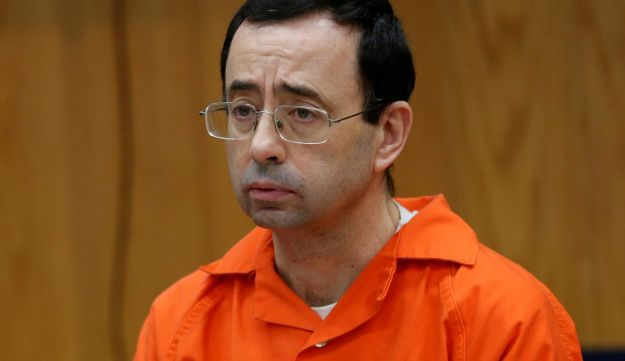 FILE PHOTO: Larry Nassar, a former team USA doctor who pleaded guilty in November 2017 to sexual assault, listens to victims impact statements during his sentencing in Michigan, Jan. 31, 2018.
