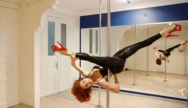 Pole dance trainer Ozge Uraz Kum performs in a pole dance class in Istanbul, February 12, 2018.