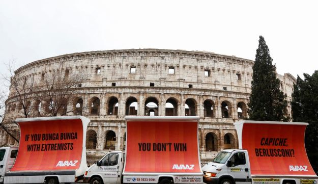 Three billboards addressing Italian former premier Silvio Berlusconi in front of the Colosseum, on the morning after election day on Monday, March 5, 2018