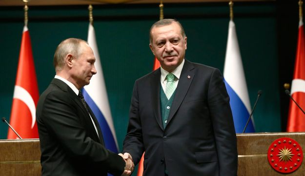 FILE PHOTO: Turkey's President Erdogan, right, shakes hands with Russia's President Vladimir Putin, left, following their joint news statement after their meeting in Turkey, December 11, 2017.