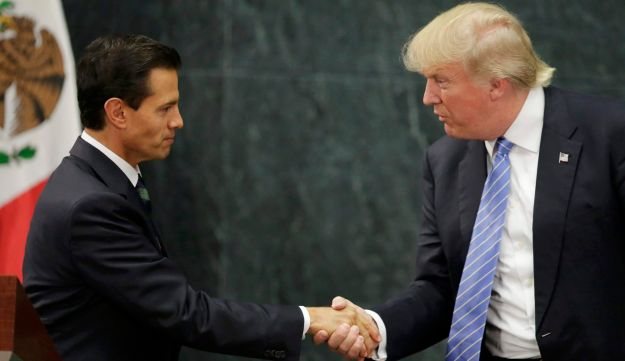 FILE PHOTO: U.S. Republican presidential nominee Donald Trump and Mexico's President Enrique Peña Nieto shake hands at a press conference at the Los Pinos residence in Mexico City, August 31, 2016.
