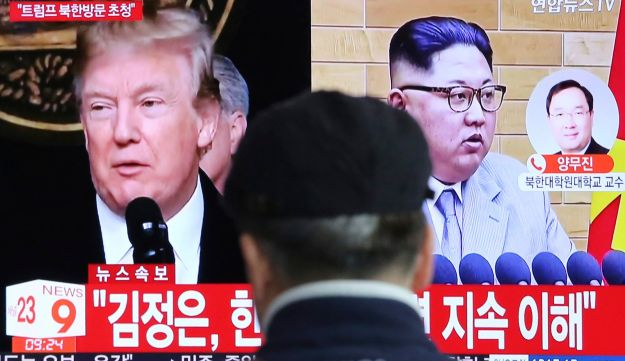A man watches a TV screen showing North Korean leader Kim Jong Un, right, and U.S. President Donald Trump, left, at the Seoul Railway Station in Seoul, South Korea, Friday, March 9, 2018