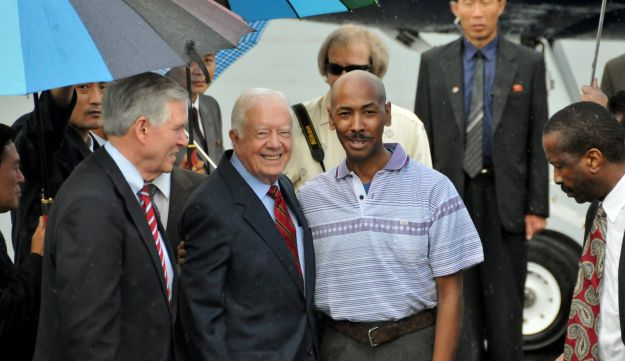 FILE - In this Aug. 27, 2010 file photo released by China's Xinhua news agency, former U.S. President Jimmy Carter, center left, poses with American Aijalon Gomes, center right, at Pyongyang airport, North Korea. U.S. President Donald Trump could become the first sitting U.S. president to visit North Korea if plans for a summit with Kim Jong Un hold. But other prominent American political figures have visited Pyongyang in the past, many with a similar goal of trying to stop its nuclear program. Carter returned in August 2010 to bring home a jailed Bostonian, Aijalon Gomes, who had entered the communist country illegally from China. He had been sentenced to eight years of hard labor in prison. In April 2011, Carter arrived in Pyongyang again, this time with other former world leaders to discuss a food shortage in the country and to try to restart talks to persuade North Korea to abandon its nuclear weapons ambitions. (AP Photo/Xinhua, Yao Ximeng)