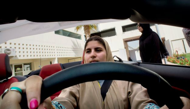 Sara Ghouth, 18-year-old student at Effat University, sits for the first time in the driver's seat, during training sponsored by Ford Motor, in Jiddah, Saudi Arabia, Tuesday, March 6, 2018. A stunning royal decree issued last year by King Salman announcing that women would be allowed to drive in 2018 upended one of the most visible forms of discrimination against women in Saudi Arabia. (AP Photo/Amr Nabil)