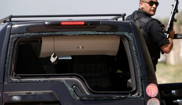 A damaged vehicle of the convoy of Palestinian Prime Minister Rami Hamdallah is seen after an explosion in the northern Gaza Strip March 13, 2018.
