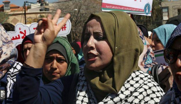 Women protest in front of the main office of the UN Special Coordinator for the Middle East Peace Process, during a rally ahead of International Women's Day, in Gaza City, March 7, 2018.
