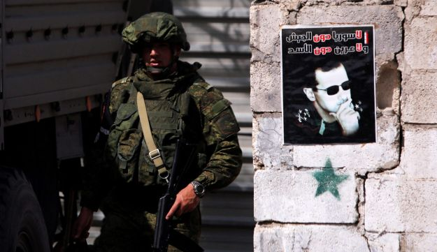 A Russian soldier is seen at Wafideen camp in Damascus, Syria March 1, 2018