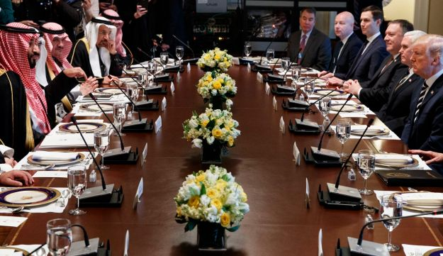President Donald Trump listens as Saudi Crown Prince Mohammed bin Salman speaks during a working lunch in the Cabinet Room of the White House, Tuesday, March 20, 2018, in Washington.