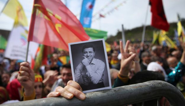 A woman holds a photograph of former co-leader of pro-Kurdish Peoples' Democratic Party, or HDP, during the Newroz celebrations in Istanbul, Wednesday, March 21, 2018.