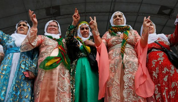 Women chant slogans on stage during the Newroz celebrations, marking the start of spring, in Istanbul, Wednesday, March 21, 2018.