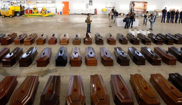Coffins of victims from a shipwreck off Sicily killing an estimated 300 Eritrean and Somali men, women and children at Lampedusa airport. October 5, 2013