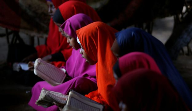 Somali refugees study the Quran at a school in the Dadaab refugee camp, Kenya. December 19, 2017