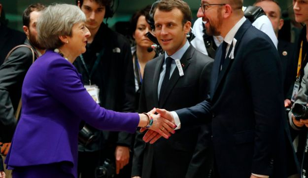rench President Emmanuel Macron and Belgian Prime Minister Charles Michel welcome British Prime Minister Theresa May during a European Union leaders summit in Brussels, Belgium, March 22, 2018