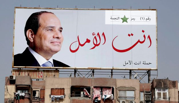 "A election banner for Egyptian President Abdel-Fattah el-Sissi hangs on top of a residential building that reads ""You are the hope"" in Cairo, Egypt on March 24, 2018."