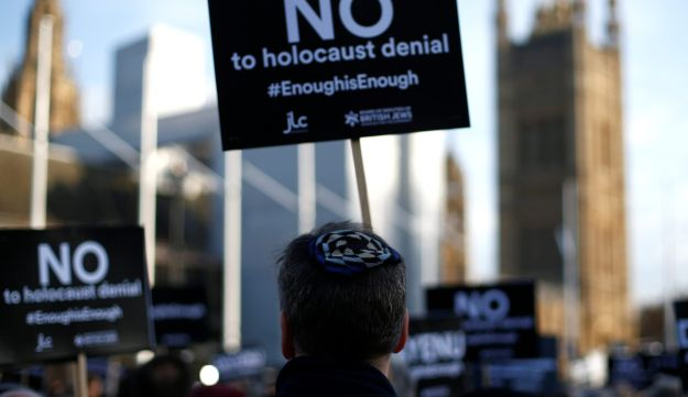 Protesters hold placards and flags during a demonstration, organised by the British Board of Jewish Deputies for those who oppose anti-Semitism, in Parliament Square in London, Britain, March 26, 2018. REUTERS/Henry Nicholls
