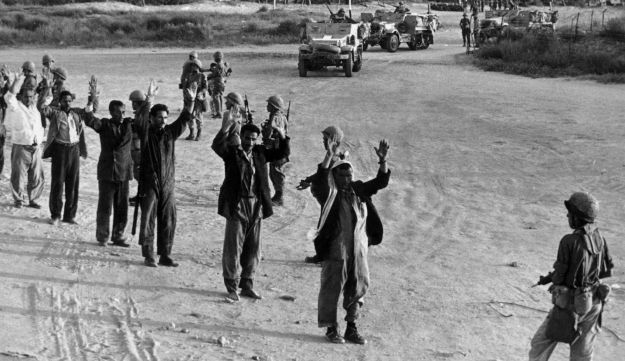 Israeli troops line up prisoners in the Gaza strip in readiness for questioning and identification on June 6, 1967, during the early stages of the Arab-Israel war