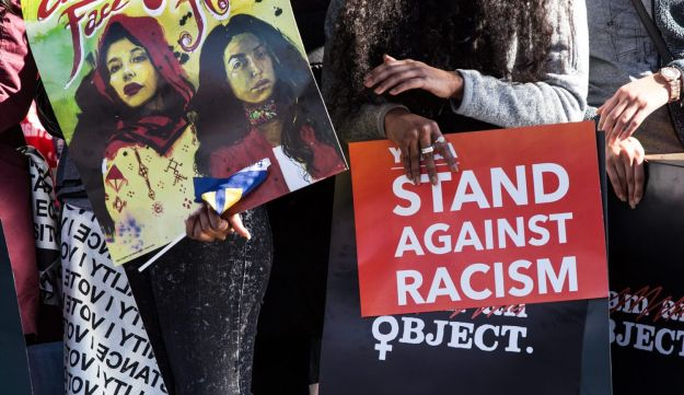 An attendee holds a sign reading 'Stand Against Racism' during the Women's March One-Year Anniversary: Power To The Polls event in Las Vegas, Nevada. Jan. 21, 2018
