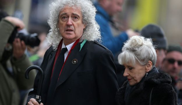 British musician Brian May and his wife, actress Anita Dobson arrive to attend the funeral at the Church of St Mary the Great, in Cambridge on March 31, 2018.