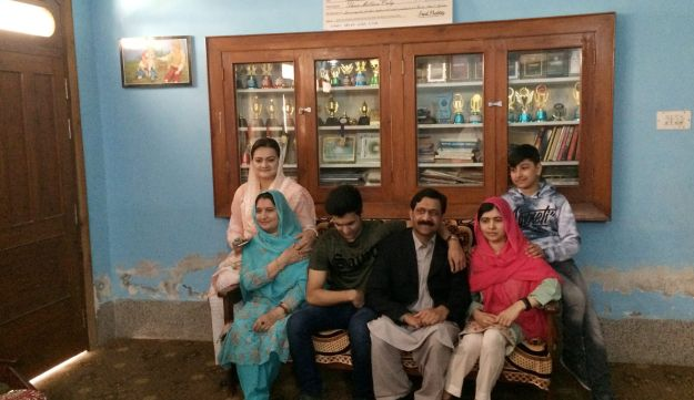 Malala Yousafzai (R-front) sits with her family and Pakistan Minister of State for Information and Broadcasting Marriyum Aurangzeb (L-back) while visiting her hometown Mingora in Swat Valley, Pakistan March 31, 2018.