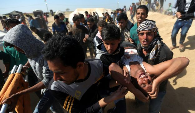 Youth react after deaf Palestinian Tahreer Abu Sabala, 17, was shot and wounded in the head during clashes with Israeli troops, at Israel-Gaza border, in the southern Gaza Strip, April 1, 2018.