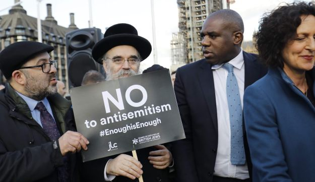 MP David Lammy, second right, joins members of the Jewish community holding the protest against anti-Semitism in the Labour Party, London, March 26, 2018.