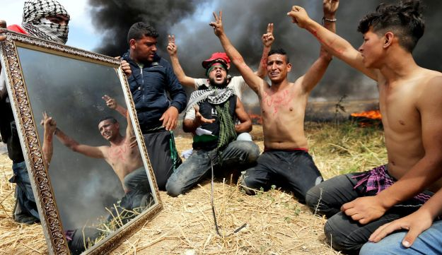 Palestinian youth protesting close to the border between Israel and Gaza.
