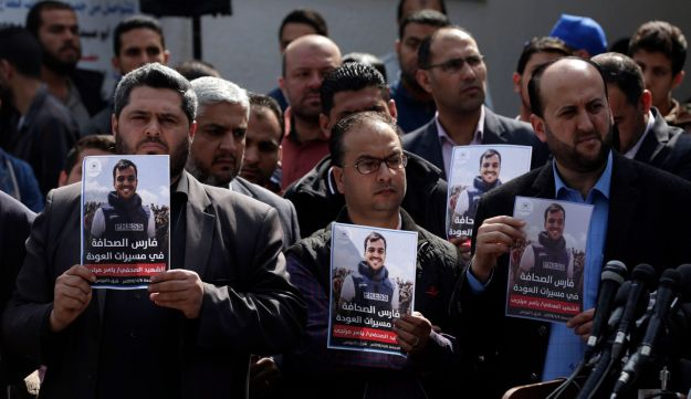 Journalists at a demonstration in northern Israeli demonstrating in solidarity with killed photojournalist Yaser Murtaja on Saturday, April 7 2018.