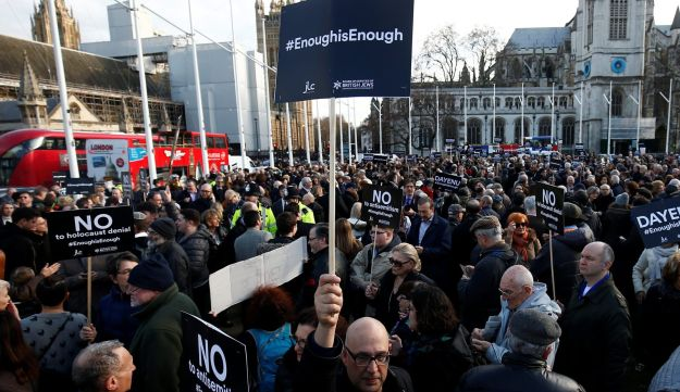 Protesters hold placards and flags during a Jewish community demonstration against anti-Semitism in the Labour Party. Parliament Square, London. March 26, 2018