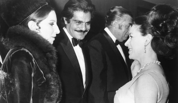 "Omar Sharif (center) talks with American singer Barbra Streisand (left) and britain's Princess Margaret (right) at the premiere of the film ""Funny Girl,"" at the Odeon Cinema, London, Jan. 15, 1969."