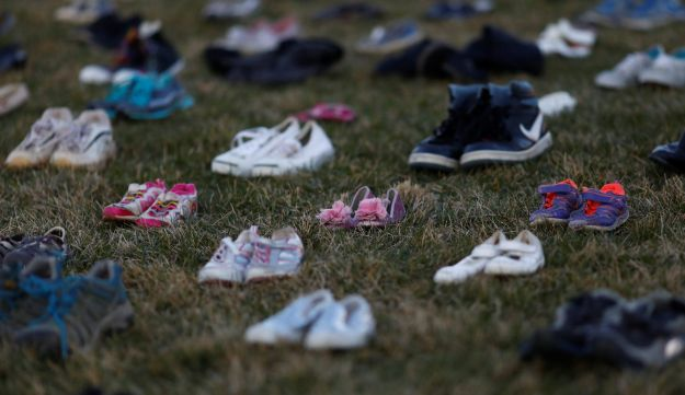 Activists install 7000 shoes on the lawn in front of the U.S. Capitol on Capitol Hill in Washington, U.S. March 13, 2018. Organizers said the installation represents the number of lives lost since the shooting at Sandy Hook elementary in Newtown, Connecticut