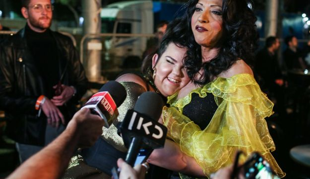1998 winner, Dana International, right, and hopeful Netta Barzilai meet backstage at the 'Israel Calling' show.