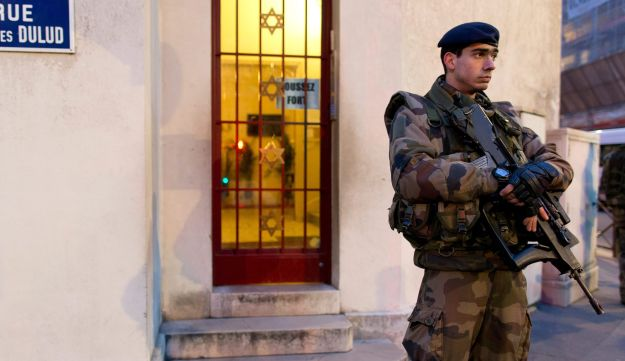"French soldiers patrol on January 21, 2015 in front of a synagogue in Neuilly-sur-Seine, outside Paris, as part of France's national security alert system Vigipirate. The anti-terrorism Vigipirate plan which has been reinforced in the wake of recent attacks will be maintained in France ""as long"" as ""risk prevails"", French Interior minister Bernard Cazeneuve said on January 16."