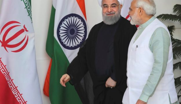 Indian Prime Minister Narendra Modi talks with Iranian President Hassan Rouhani, as they arrive for their meeting in New Delhi, India. Feb. 17, 2018