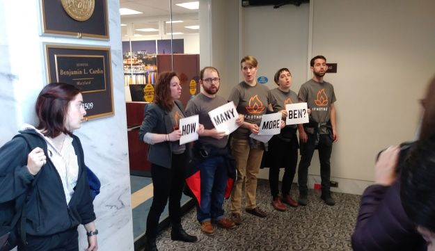 U.S. Jewish activists block the entrance to the office of Senator Ben Cardin (D-MD) on Monday, April 16 2018.