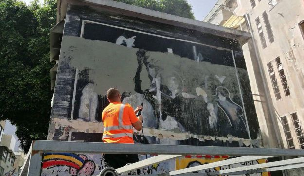 Yigal Shtayim's mural being painted over on Tuesday morning